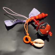 TOUBAB PARIS - Bijou de portable fantaisie Mini Grigri orange